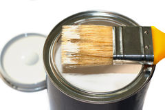 Brush and open paint pot Stock Images