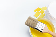 Brush over can of yellow paint Royalty Free Stock Photos
