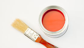 Brush and paint. A can of red paint with a brush on top with a red coloured tip stock photos