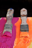 Brush and paint. Several colorful brushes and paint Royalty Free Stock Images