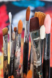 Brush and paint. Several colorful brushes and paint Stock Images