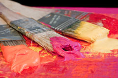 Brush and paint. Several colorful brushes and paint Royalty Free Stock Photo