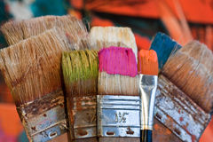 Brush and paint. Several colorful brushes and paint Royalty Free Stock Photography
