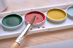 Brush in paint stock image