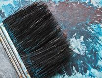 Brush. Paint brush with blue paint stock photography
