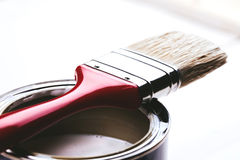 Brush on paint can Stock Photos