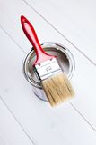Brush on paint can Stock Photo