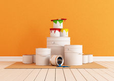 Brush and paint cans on cardboard Royalty Free Stock Photos