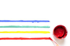 Brush with paint and colored stripes.  Stock Photography
