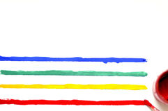 Brush with paint and colored stripes.  Stock Photos