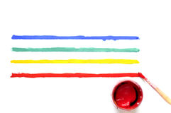 Brush with paint and colored stripes.  Stock Images
