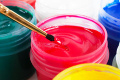 Brush and paint jar Stock Images