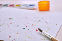 Brush and paint on white page stock photos