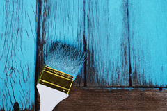 Brush Painting Blue on the Wood Stock Photo