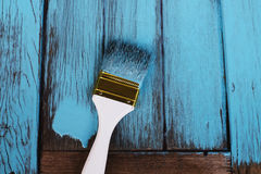 Brush Painting Blue on the Wood Stock Photography