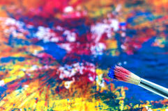 Brush on a painting. Painting brush and detail of a painting Royalty Free Stock Images