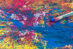 Brush on a painting. Painting brush and detail of a painting Royalty Free Stock Image