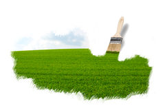 Brush painting a green field stock image