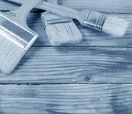Brush painting paint on wooden background Stock Images
