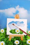 Brush painting spring landscape on easel Stock Image