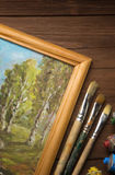 Brush and painting  on wood Royalty Free Stock Images