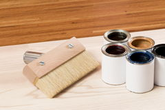 Brush for painting wood and open cans of paint Royalty Free Stock Images