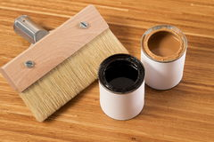 Brush for painting wood and open cans of paint Stock Photo
