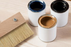 Brush for painting wood and open cans of paint Royalty Free Stock Photos
