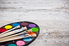 Brush and paints Stock Photography
