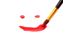 Brush paints smile Royalty Free Stock Photography