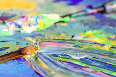 Brush and palette knife on painting. Brush and palette knife on an abstract painting Royalty Free Stock Images
