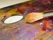 Brush and palette with oil paints. Close-up of brush and palette with oil paints Royalty Free Stock Photography
