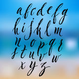 Brush pen hand lettered english alphabet Stock Photos
