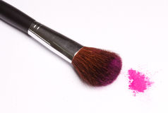Brush and powder. Brush and pink powder isolated over white Royalty Free Stock Image
