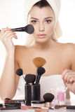 Brush for powder. Girl applied loose powder on her face with a brush for powder stock image