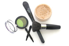 Brush powder and eye shadow isolated white. Brush powder and eye shadow isolated over white stock images