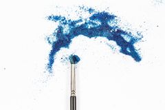 Brush and a powder spread out Royalty Free Stock Images