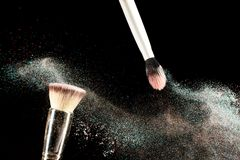Brush and a powder spread out Stock Photo