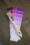 Brush on a purple color palette Royalty Free Stock Images