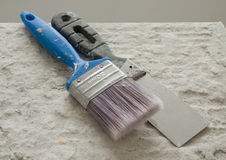 Brush and putty knife Stock Photo