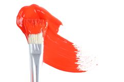 Brush with a red paint. On white royalty free stock photography