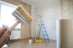 Brush for renovation in apartment Royalty Free Stock Images