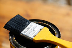 Brush resting on a tin can of protective paint Royalty Free Stock Photos