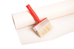 Brush and roll of wallpaper Stock Photo