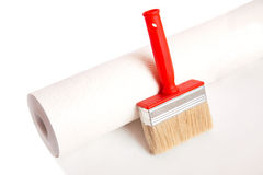 Brush and roll of wallpaper Royalty Free Stock Images