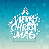 Brush rough hand lettering 'Merry Christmas'. On turquoise snow background for christmas cards, posters or banners Stock Photo