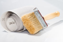 Brush and sandpaper Stock Image
