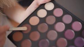 Brush and set makeup eyeshadow. 1 stock video footage