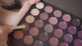 Brush and set makeup eyeshadow. 1 stock footage
