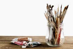 Brush set with oil paints stock image